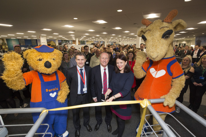 Cutting the ribbon at the opening of  the refurbished Thomas Cook Call Centre in Larbert