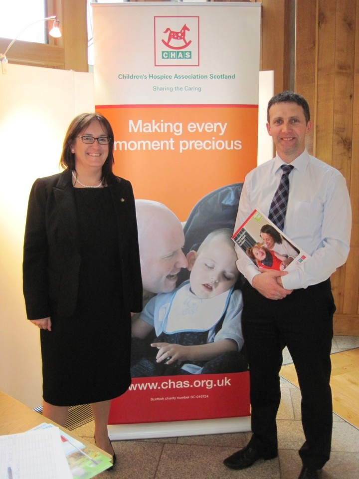 Michael visits CHAS stall that the Parliament meeting Maria McGill
