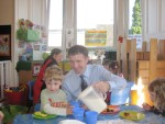 Michael acting as a milk monitor at the Wellside Kindergarten in Wellside Place, Falkirk