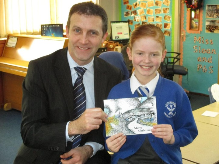 Michael with Wallis Mooney of St Andrew's Primary, Winner of his Christmas Card Competition