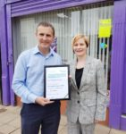 Receiving Carer Positive Employer Award from Fiona Collie of Carers Scotland